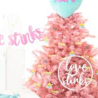 Cute pink Valentine's day tree with a fun anti valentine love stinks theme.