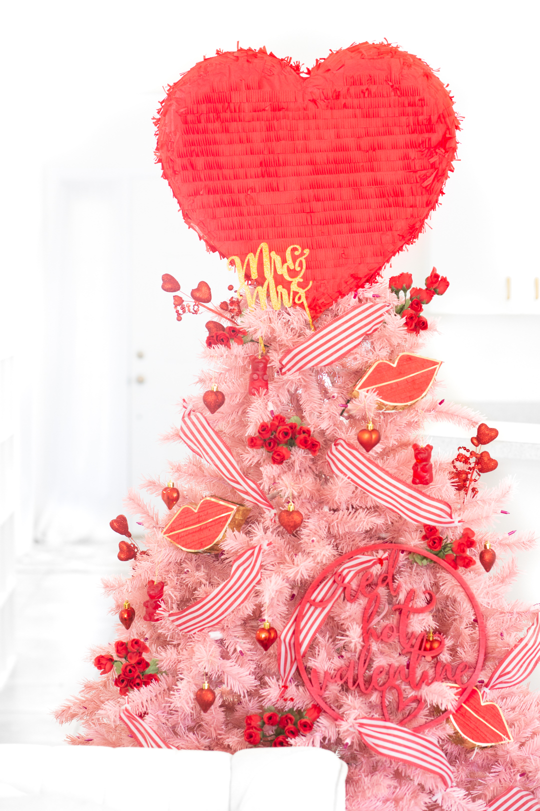 pink valentine's day tree with pinata tree topper