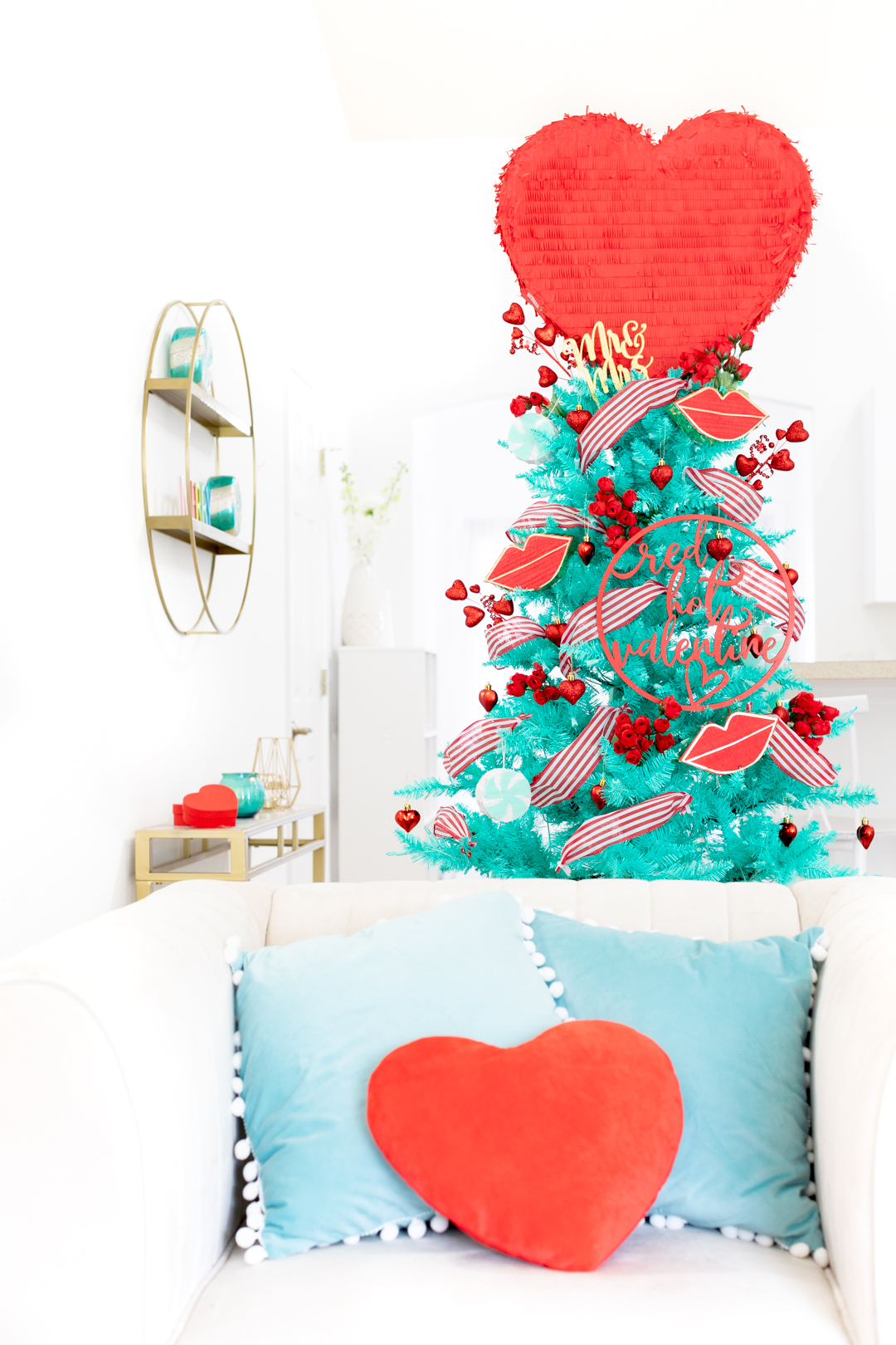 Romantic Valentine's day Christmas tree with big red heart pinata topper. Vintage tree. Cute for newlyweds.