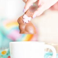 putting chocolate hot cocoa easter bunny into a giant mug