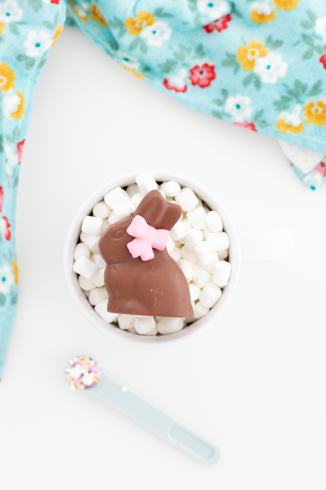 chocolate bunny inside a large mug loaded with mini marshmallows