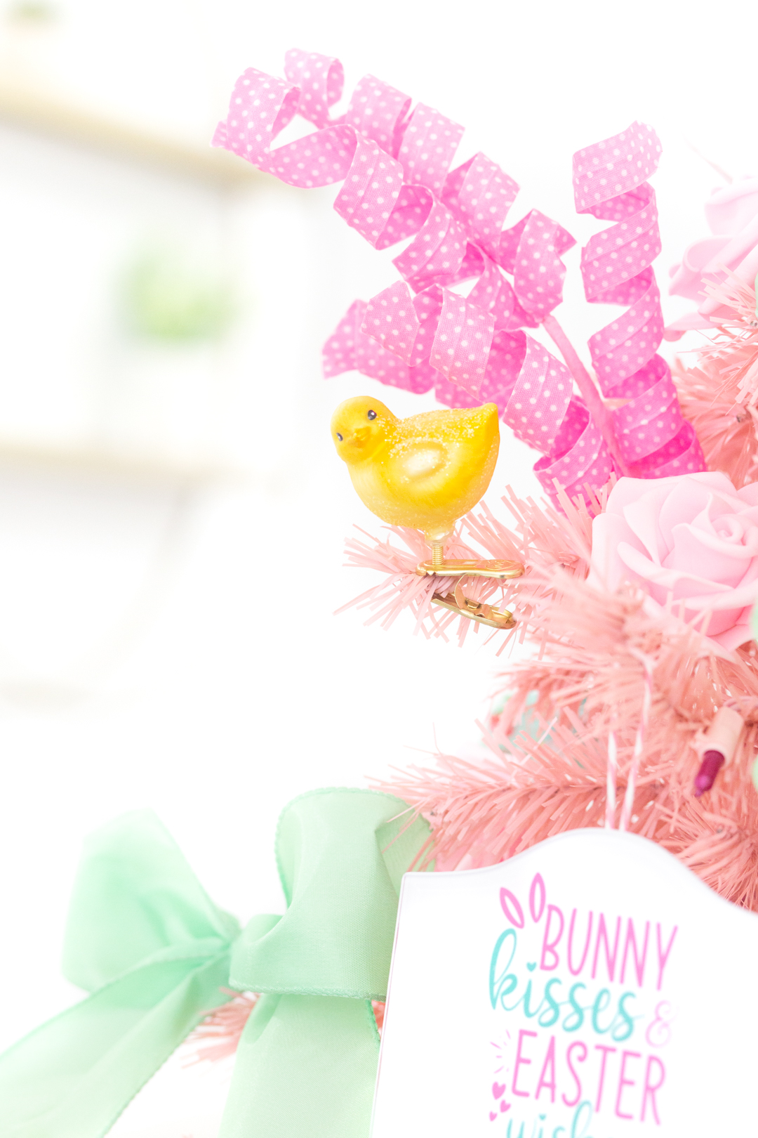 adorable baby chick ornament on a christmas tree decorated for Easter