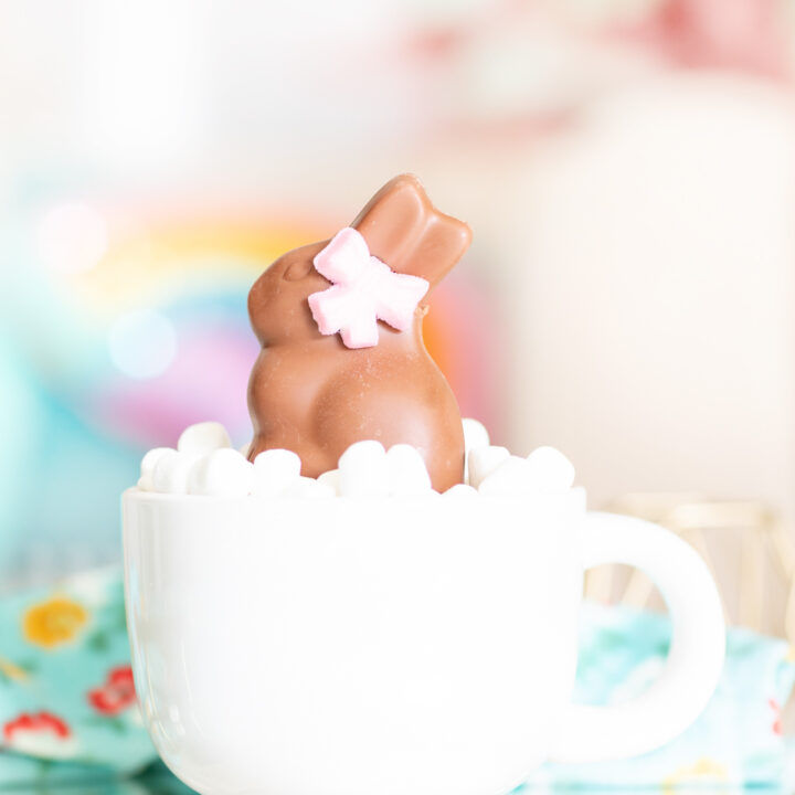 lindt gold bunny inside of a giant mug loaded with mini marshmallows
