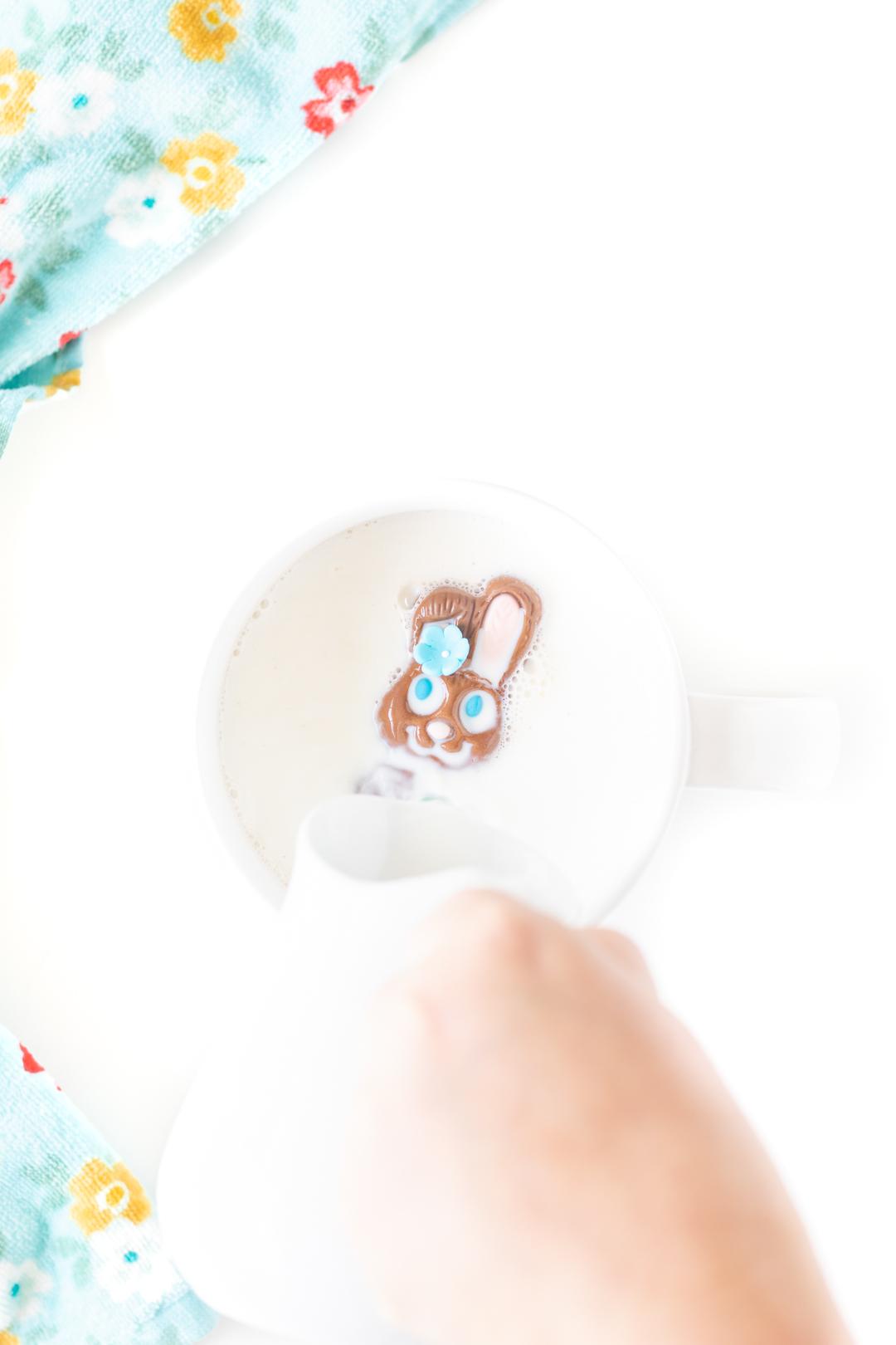 hot milk being poured into a mug