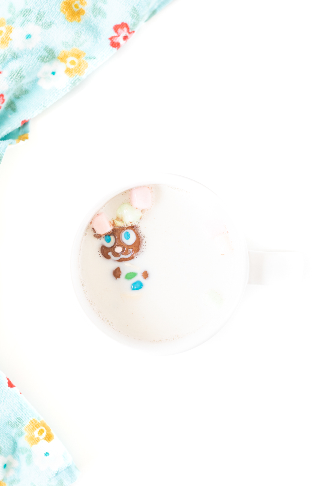 easter bunny cocoa melt being melted in a mug of hot milk as marshmallows pop out