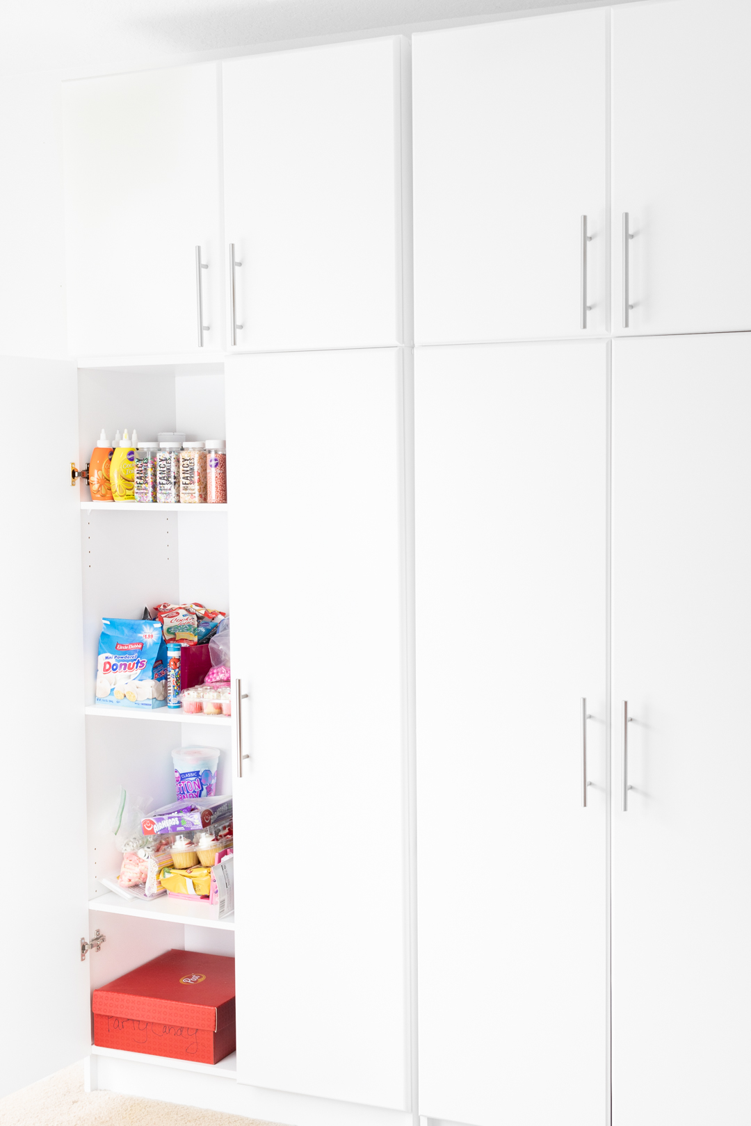 photography supplies organizational cabinet with baking ingredients and sprinkles.
