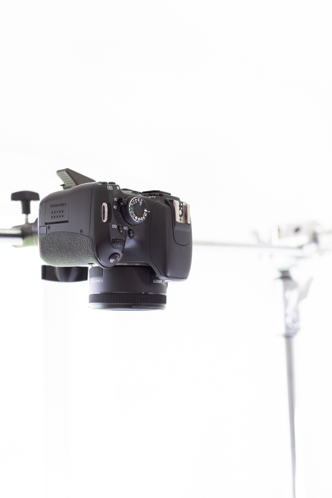 up close of a camera being rigged up with a photography c stand