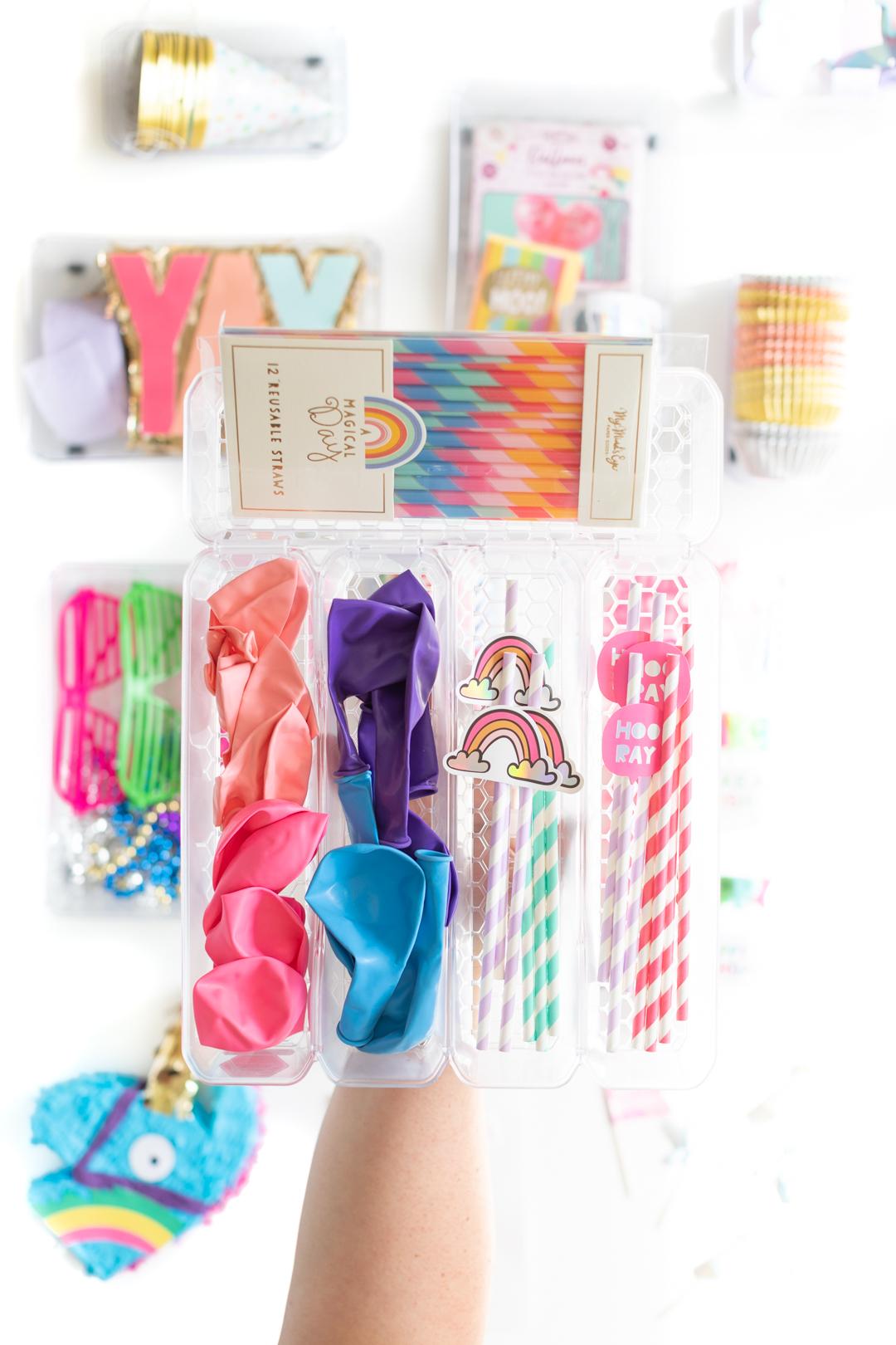 balloon and straw organization in a small bin