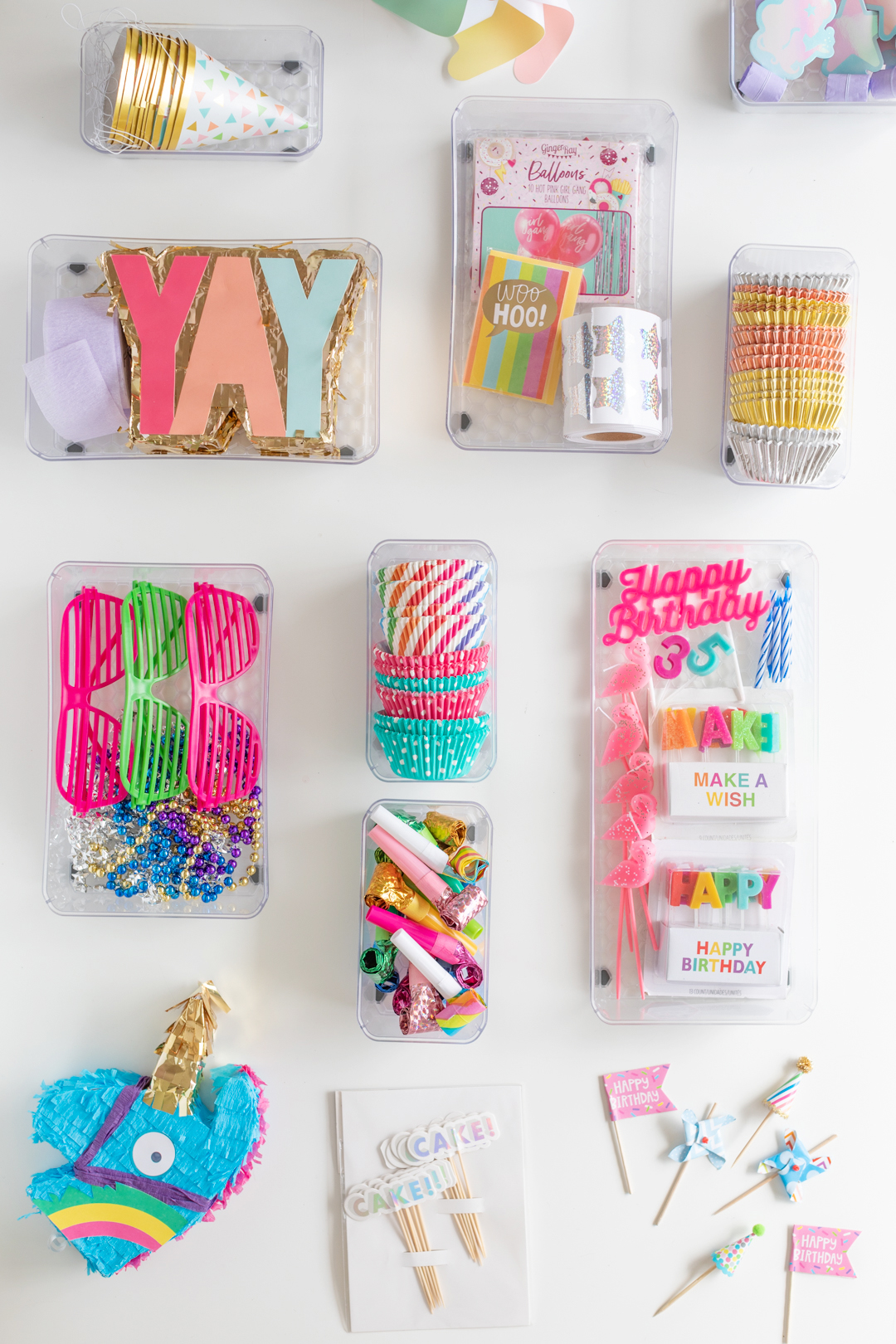 overhead photo of a variety of ways to organize party supplies and celebration supplies