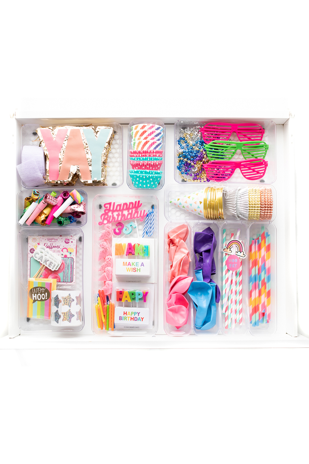 inside view of a celebration drawer. Party supply drawer instead of a junk drawer. Filled with common and basic party supplies for everyday celebrations.