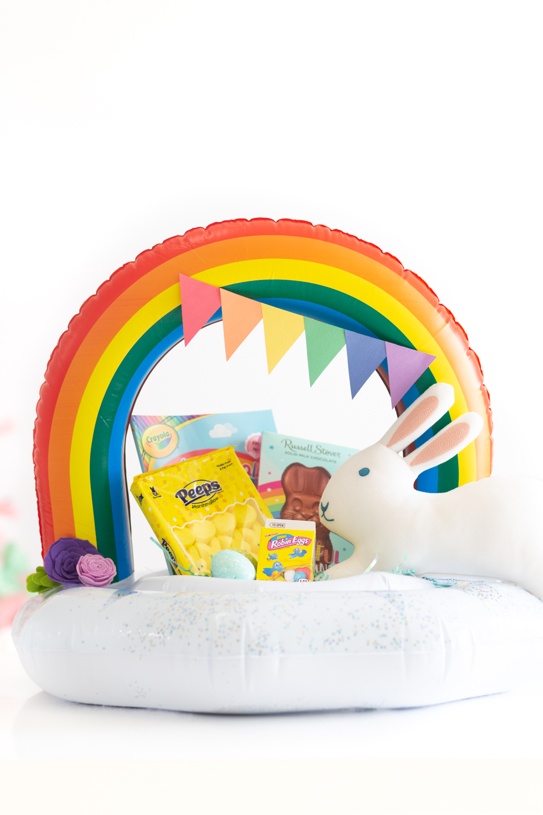 Alternate Easter Basket idea using a pool float. Cute construction paper rainbow to decorate.