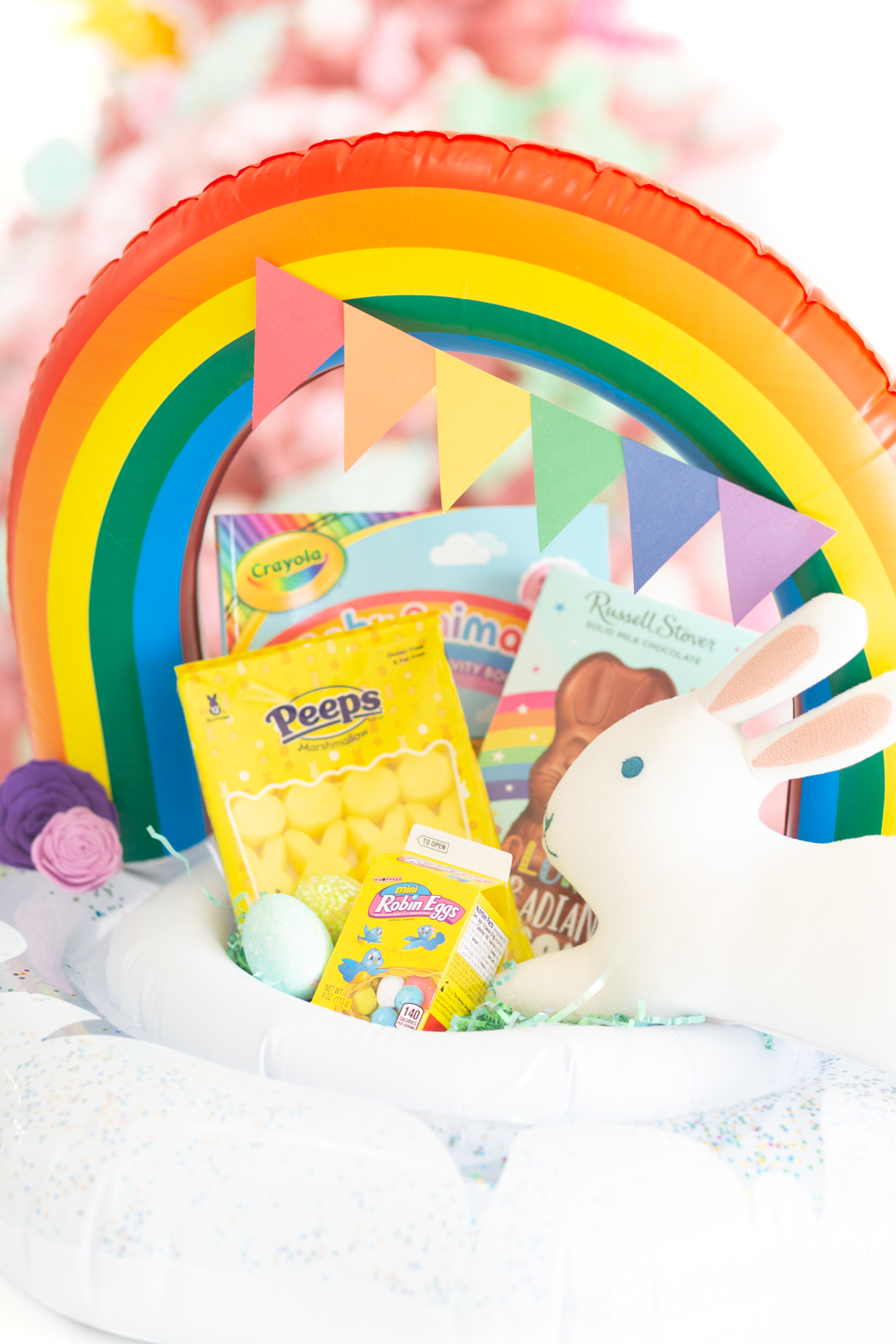 cute rainbow easter basket made out of an infant pool float.