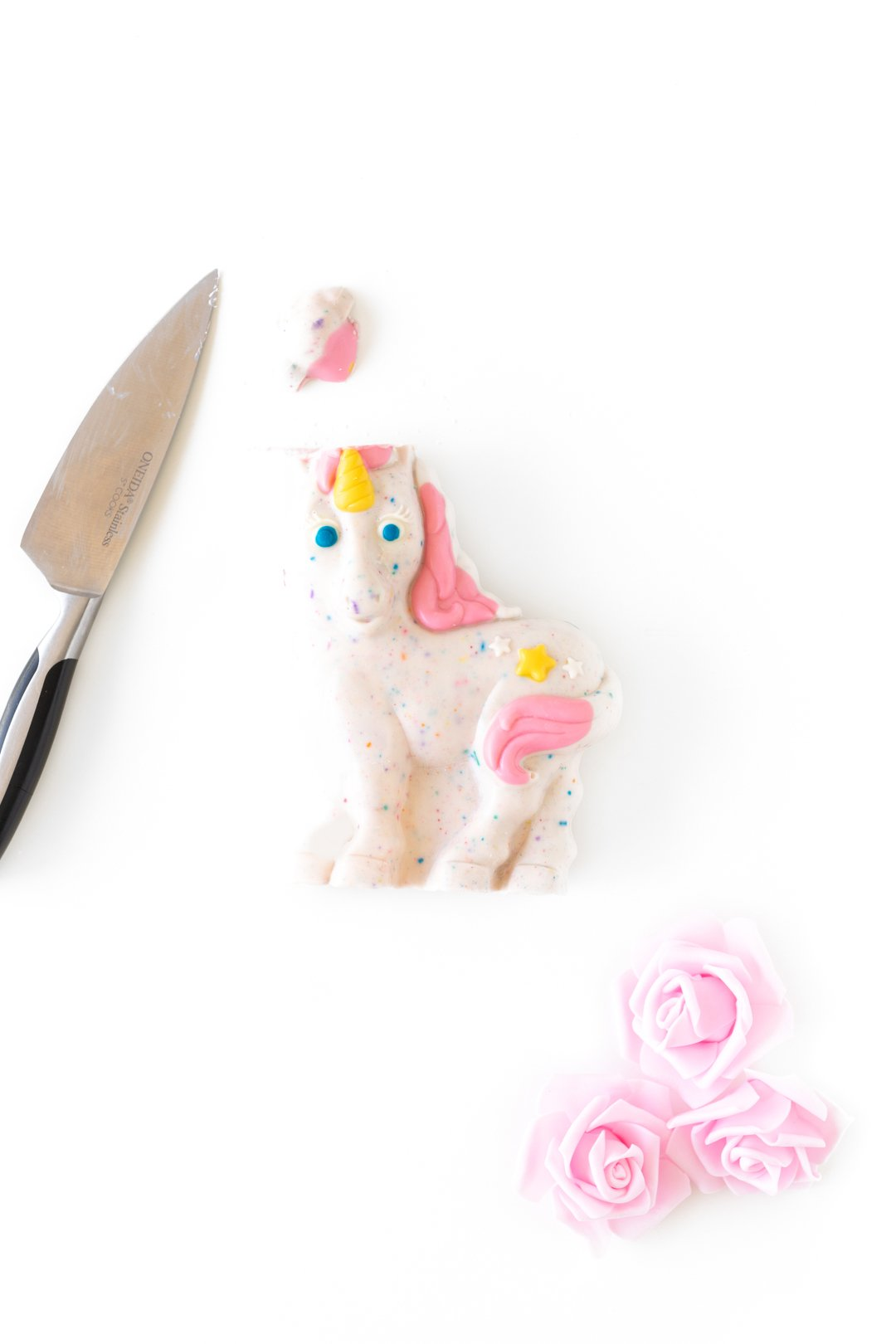 melting top off of hollow chocolate unicorn with a knife