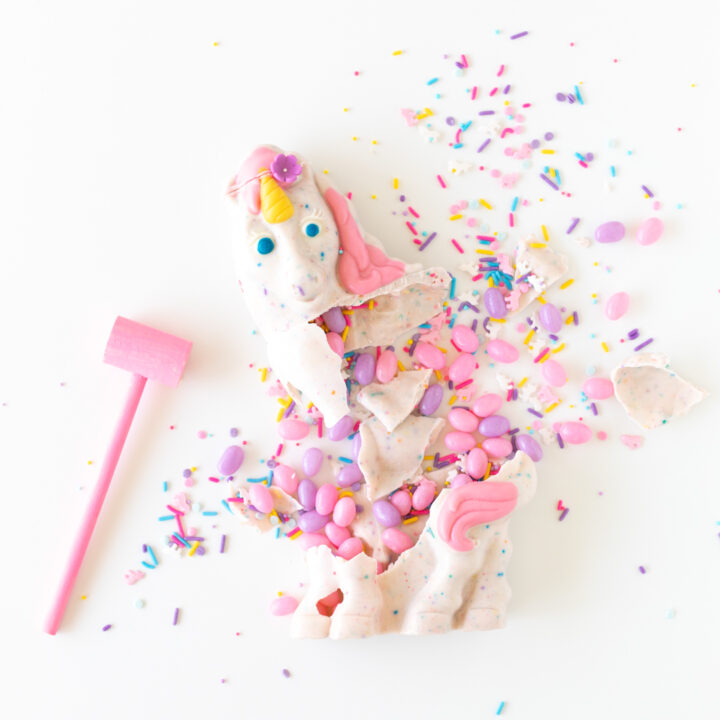 Smash unicorn with sprinkles and pastel jelly beans using a painted pink mini mallet