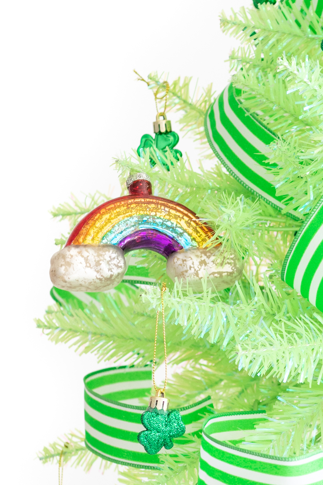 st. patrick's day ornaments. Glass rainbow ornament and green and white striped ribbon used to decorate for St. Patrick's Day.