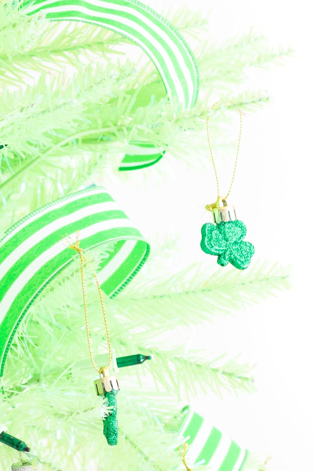 mini shamrock ornament on a light green christmas tree