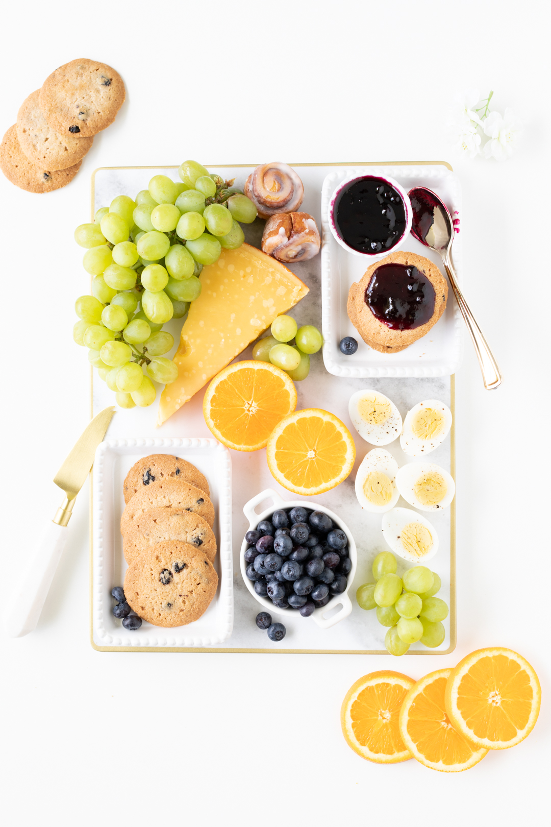 easy brunch tray for every day occasions with blueberries cookies, fresh fruit and hard cooked eggs