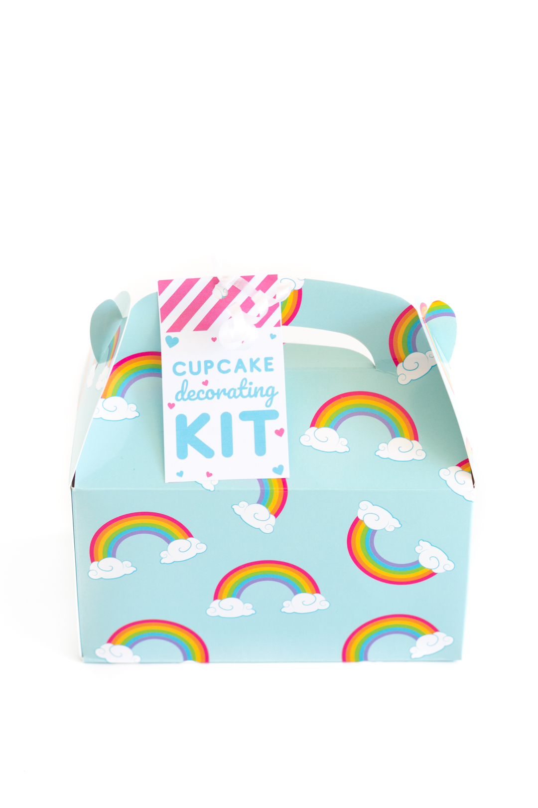 small rainbow treat box with a tag that reads cupcake decorating kit