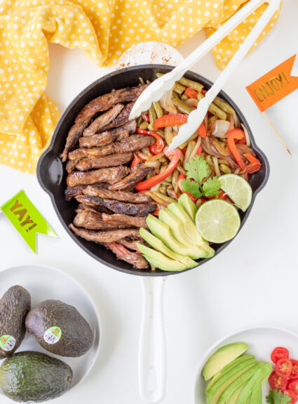 Steak fajitas prepared and ready to be served out of a skillet