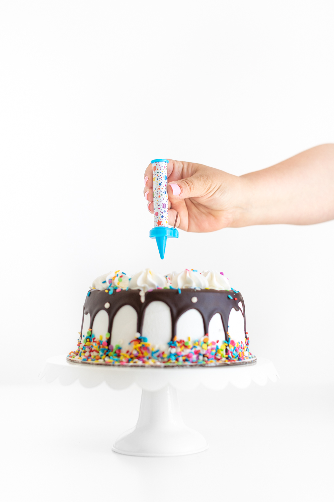 adding a surprise candle on top of a birthday cake