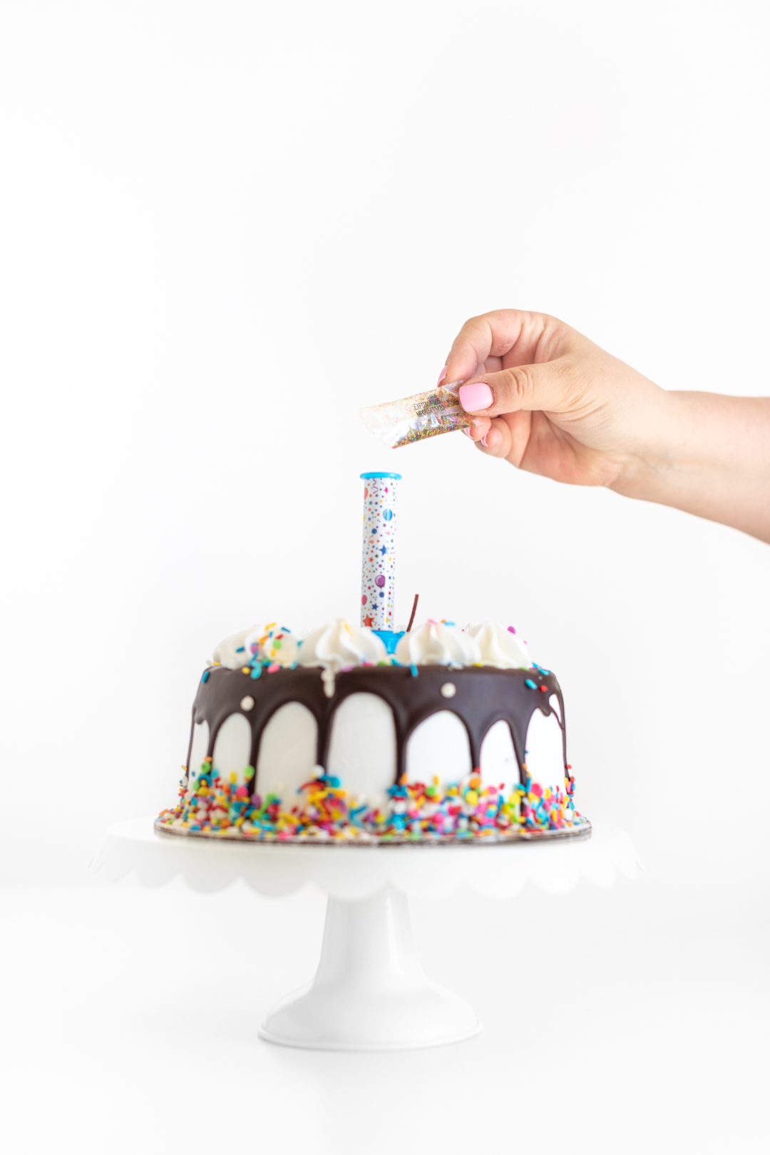 adding edible glitter to a party popper candle