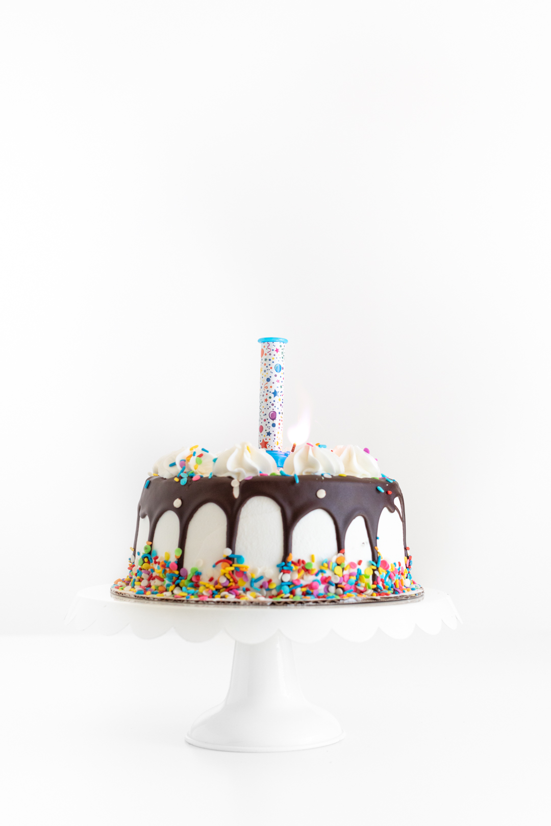 lit up birthday candle party popper waiting for edible confetti to pop out