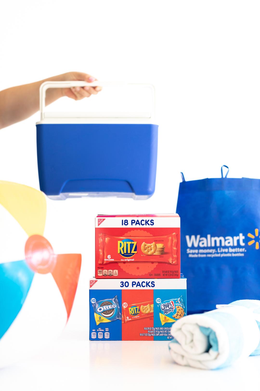 multipacks of nabisco snacks, reusable walmart bag, beach ball and mini cooler