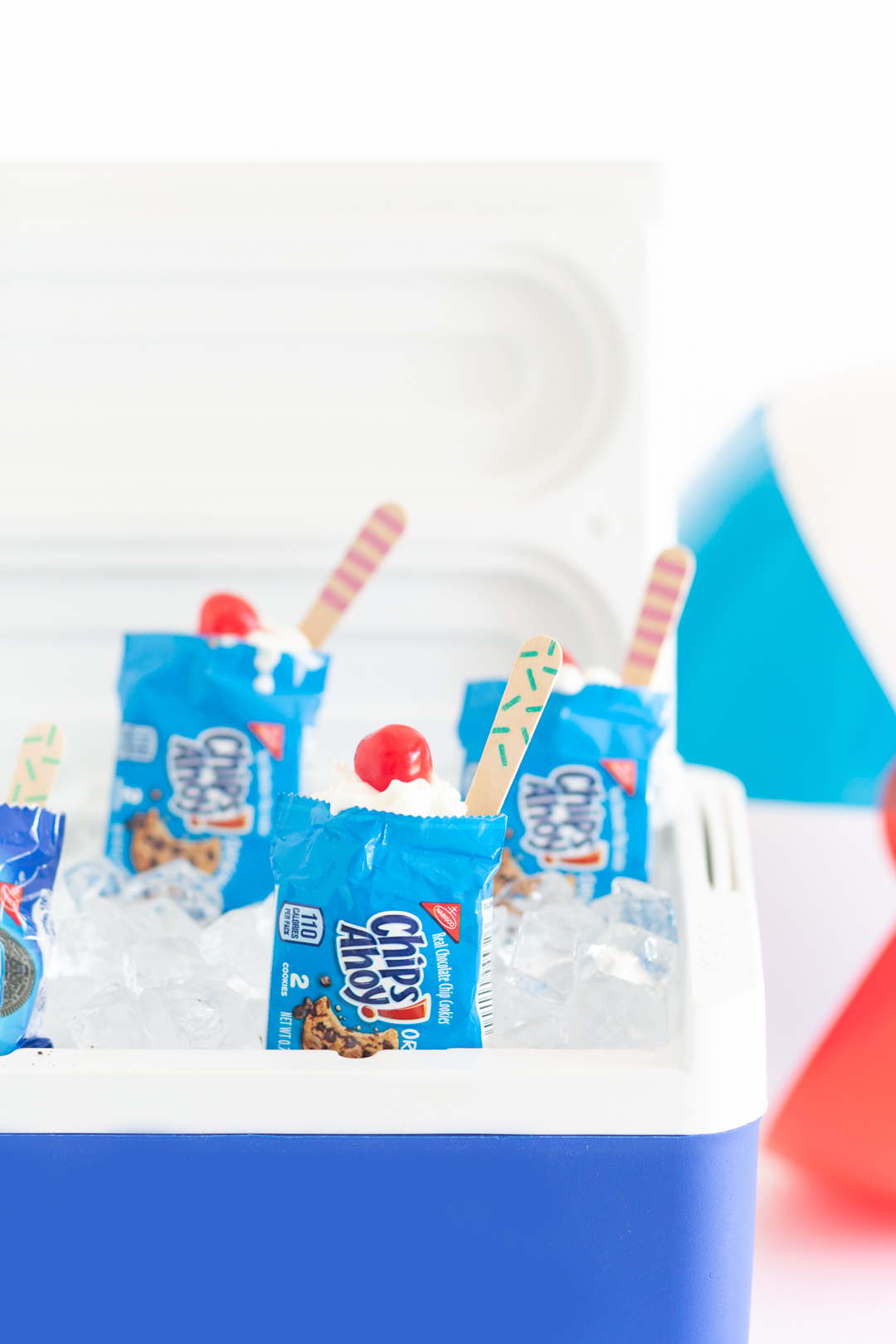 handheld desserts being served out of a cooler with ice
