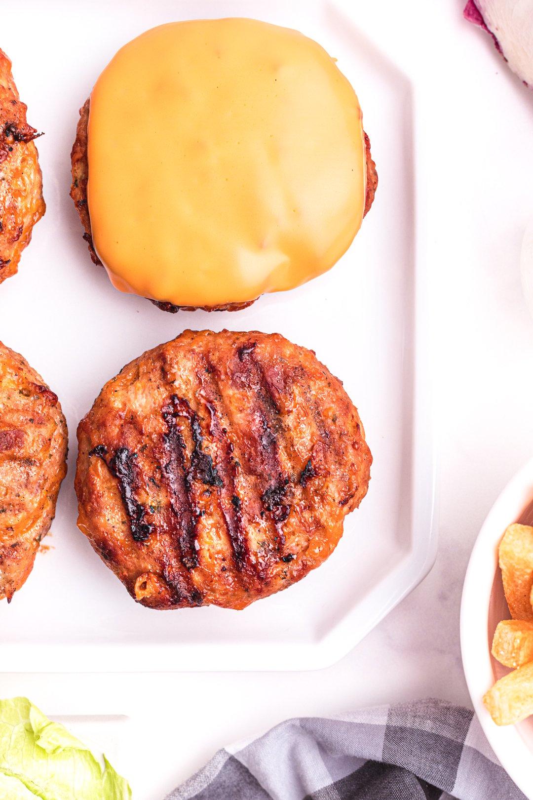 prepared grilled chicken patties on a serving platter