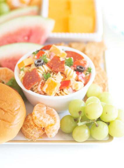 bbqterie tray with bowl of pasta salad, fresh fruits