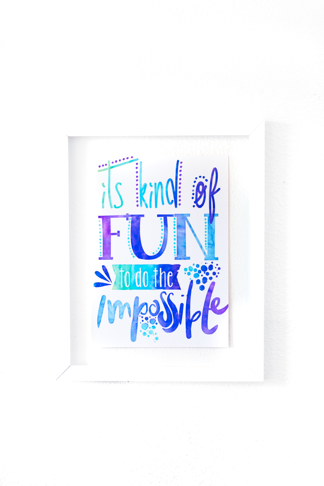 """small poster hung on the bathroom wall that reads """"it's kind of fun to do the impossible"""". A walt disney quote printed through an artist on redbubble."""