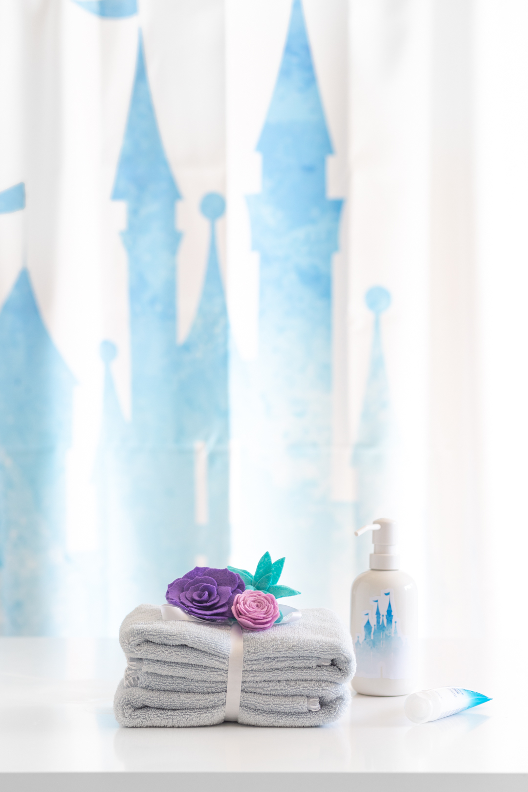 """stack of towels with felt flowers on top. Towels given the """"rapunzel"""" treatment."""