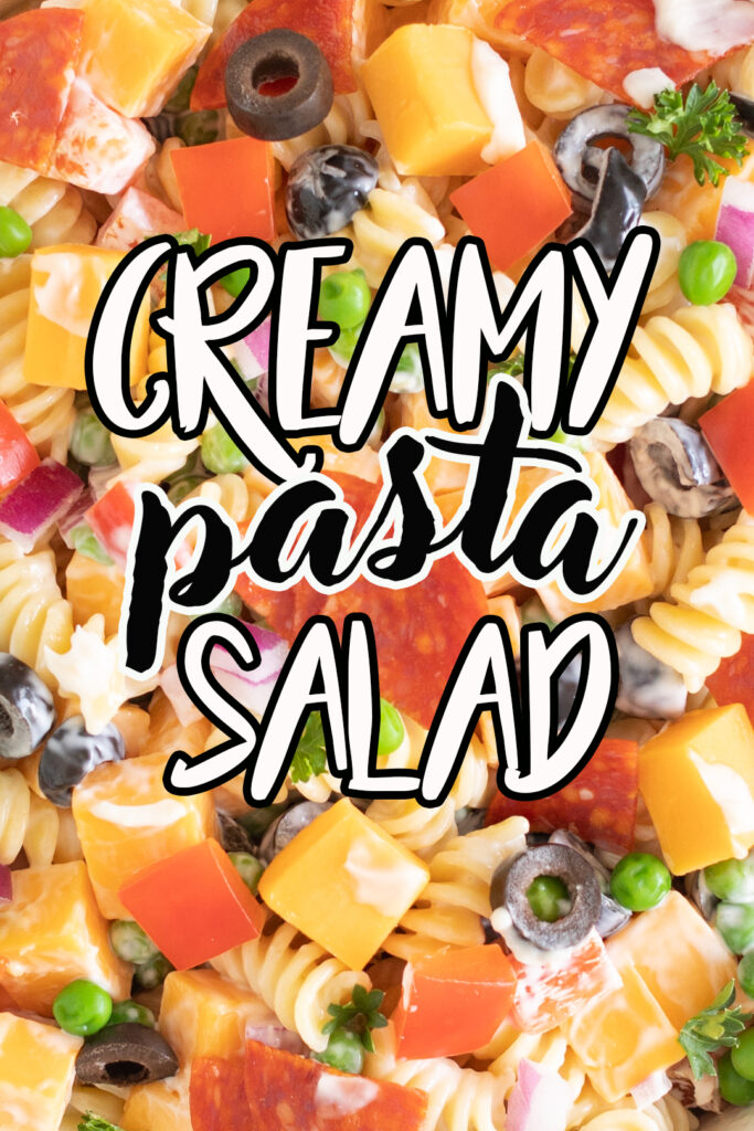 Throwback recipe for a classic, creamy pasta salad with pepperoni, cheddar chunks, peas and mayonnaise. Perfect side dish to serve at picnics and barbecues!