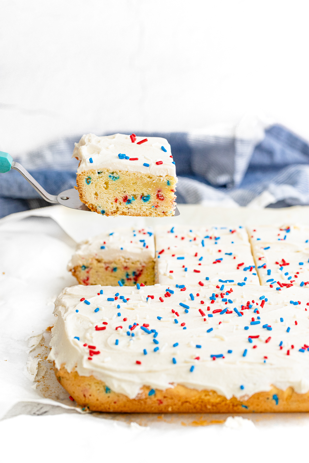 using a serving spatula to serve a slice of thick sugar cookie bar