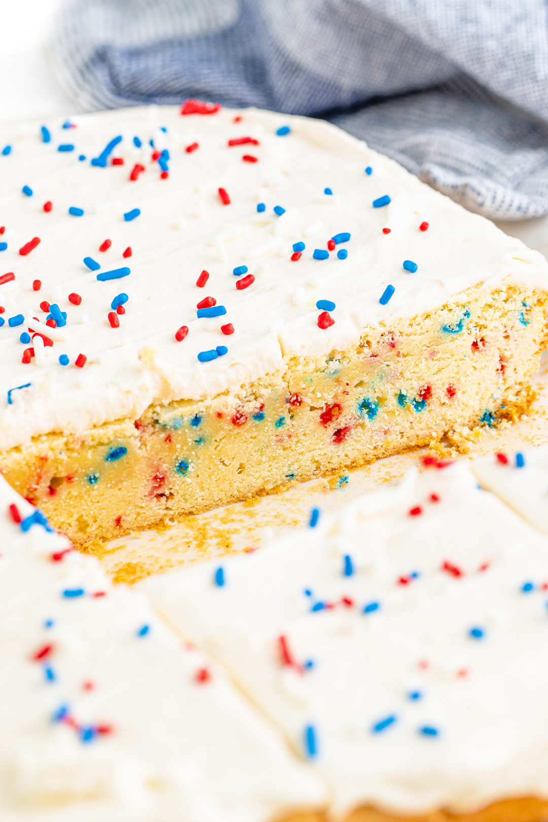 inside view of a huge sugar cookie slap with patriotic colored sprinkles inside and on top of frosting.