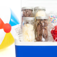 Mason Jars packed with chocolate and vanilla ice cream and loaded into a cooler to take to-go.