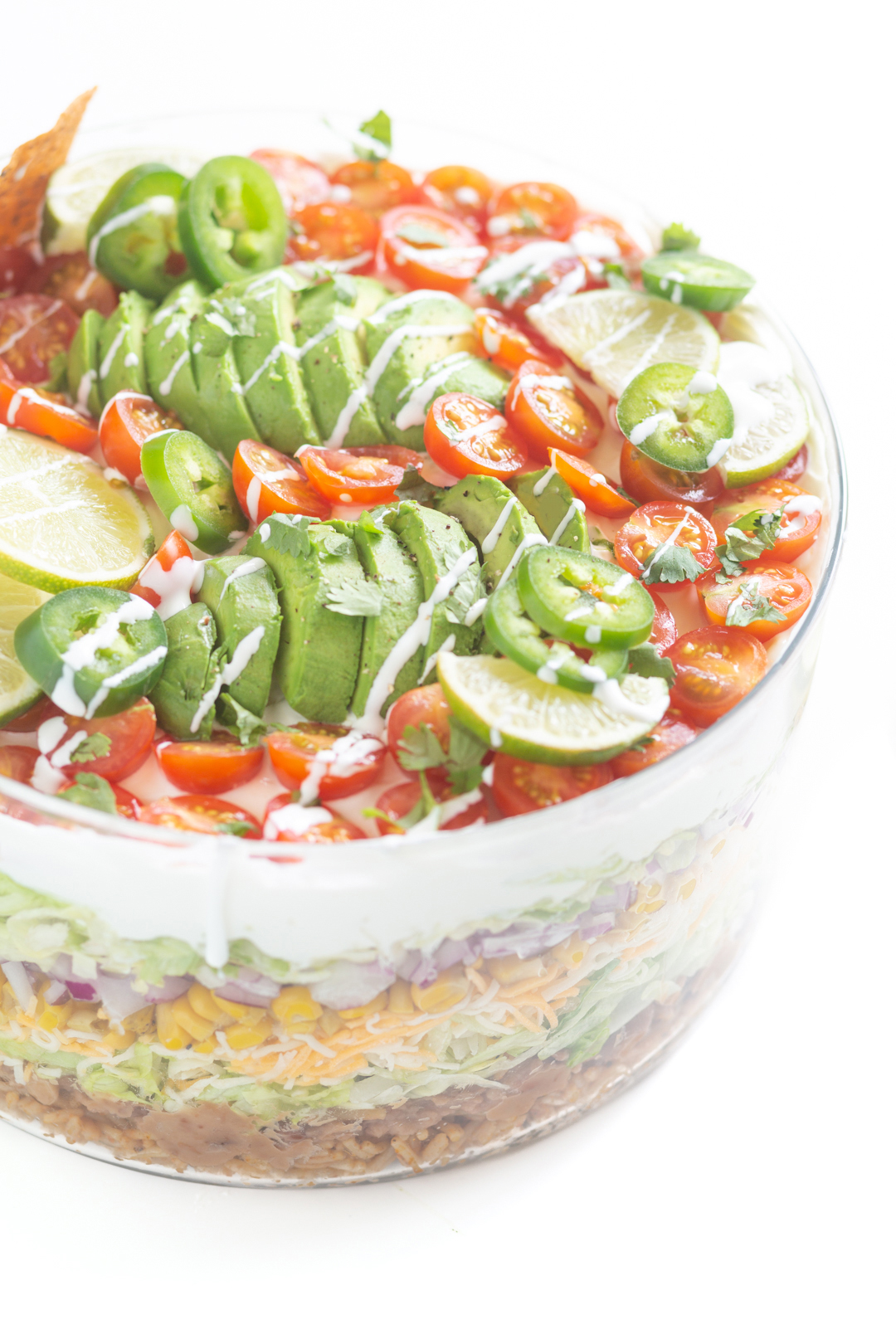 top of mexican salad drizzled with Cacique Crema Mexicana Table Cream