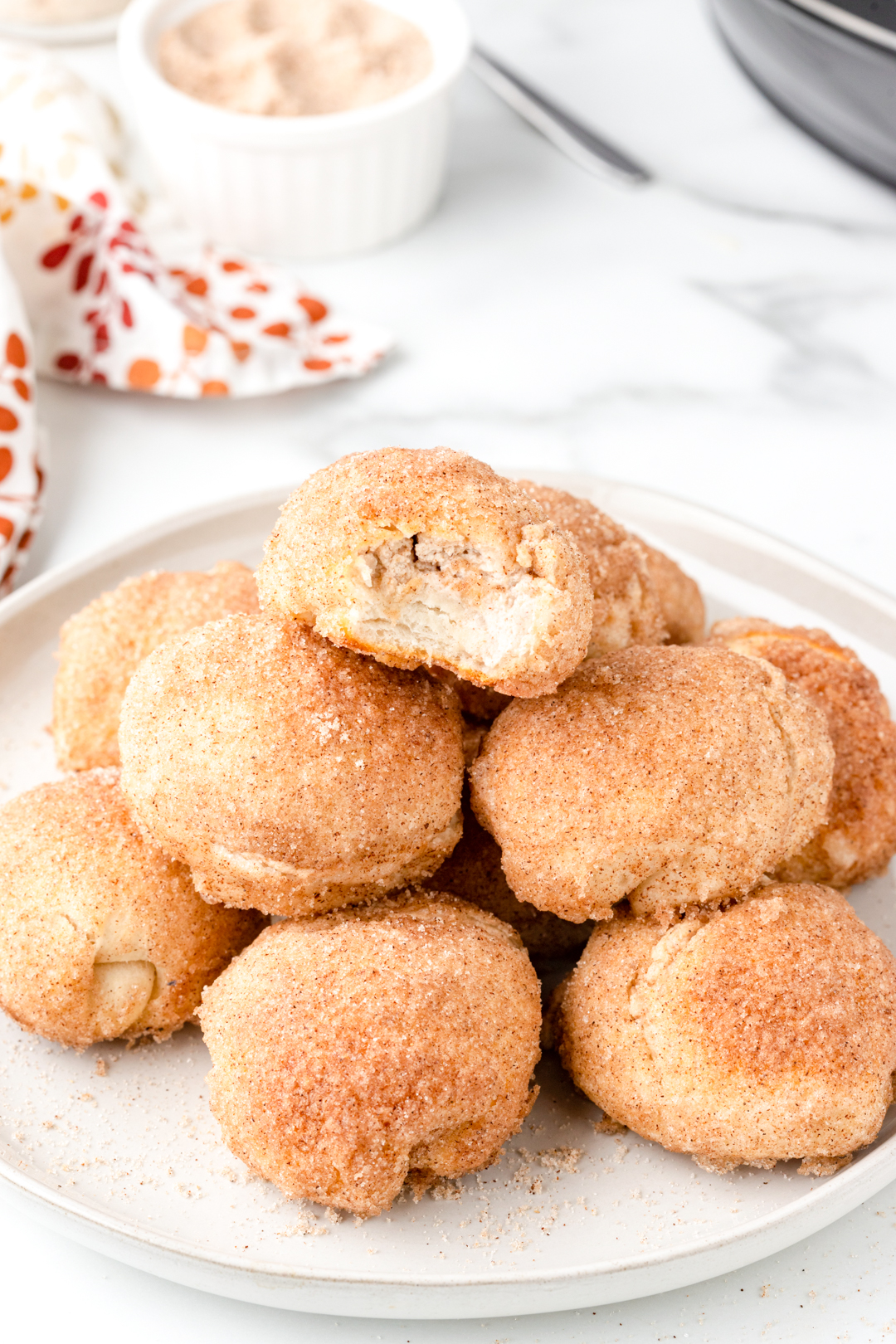 plate of pumpkin spice donut holes stuffed with cream cheese