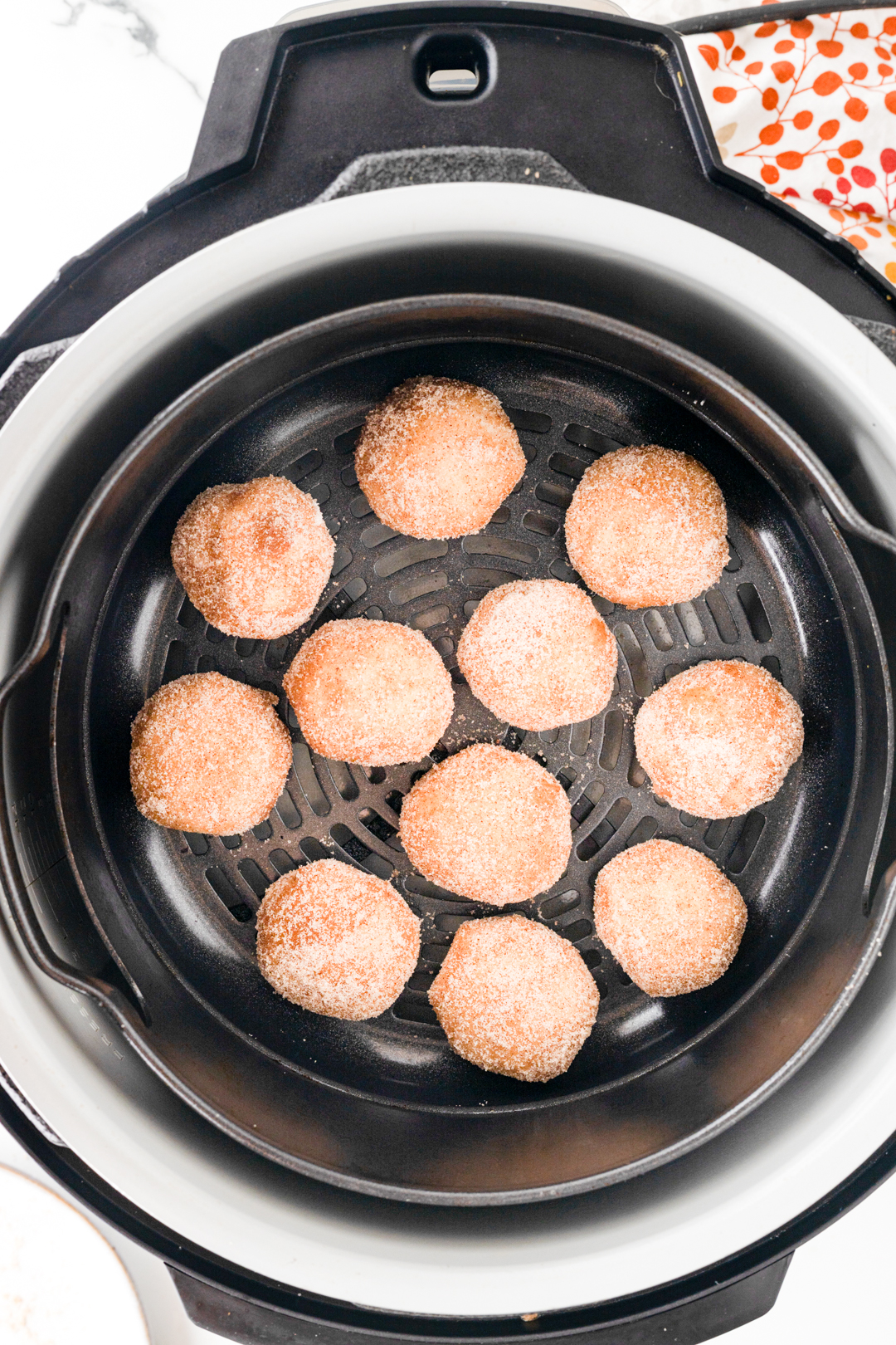 donut holes placed into air fryer before cooking