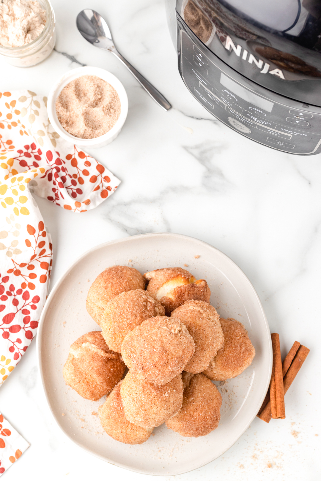 pumpkin spice donut balls stacked on a plate