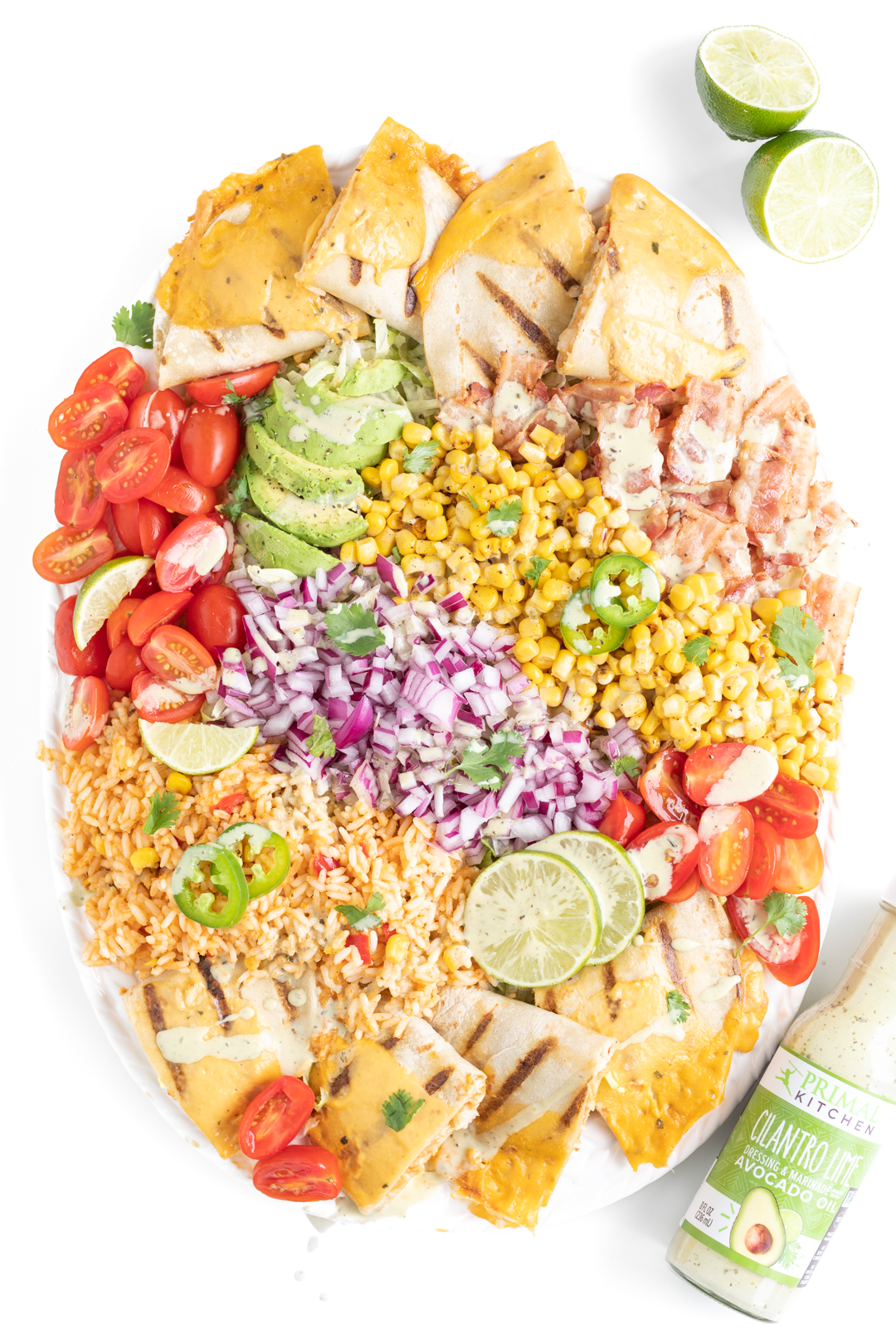 vibrant mexican salad with dressing drizzled all over it.