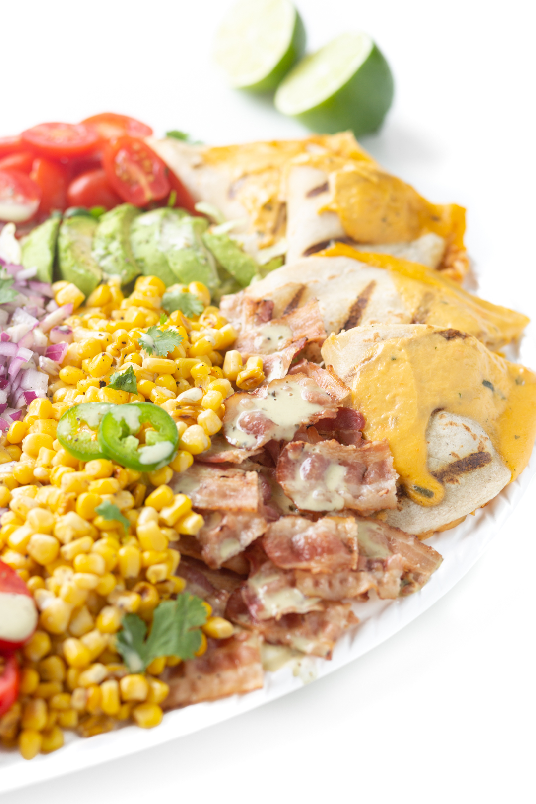 close up of salad with bacon, quesadillas, diced onion