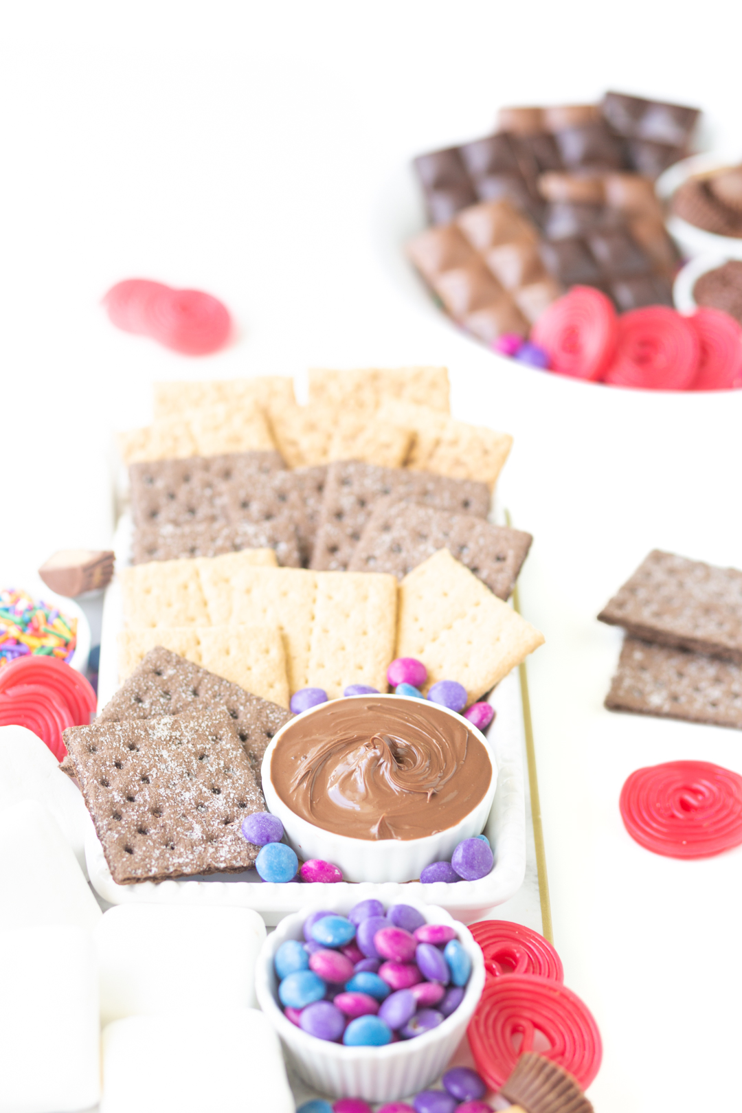 s'mores dessert platter filled with three varieties of graham crackers, candies, chocolates and marshmallows