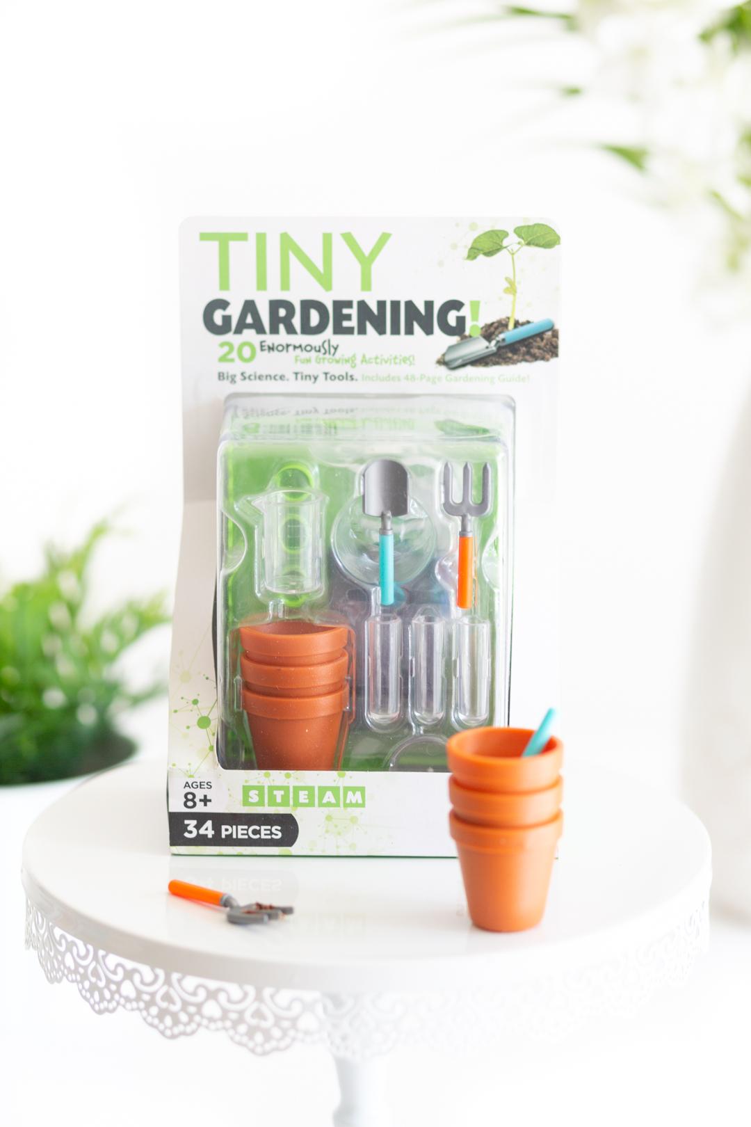 tiny gardening kit complete with mini greenhouse, mini planting posts