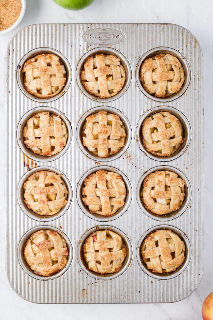 mini apple pies prepared in a muffin tin, overhead photo