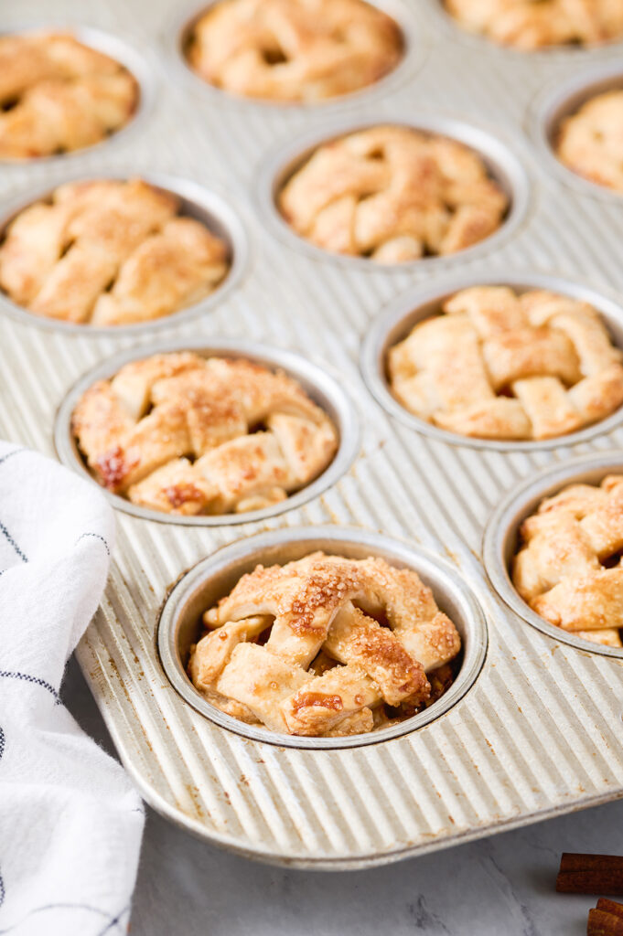 muffin tin filled with mini apple pies