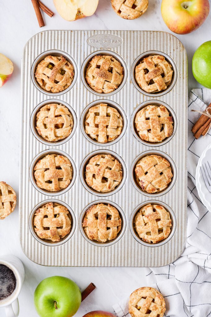 baked apple pie minis in a muffin tin