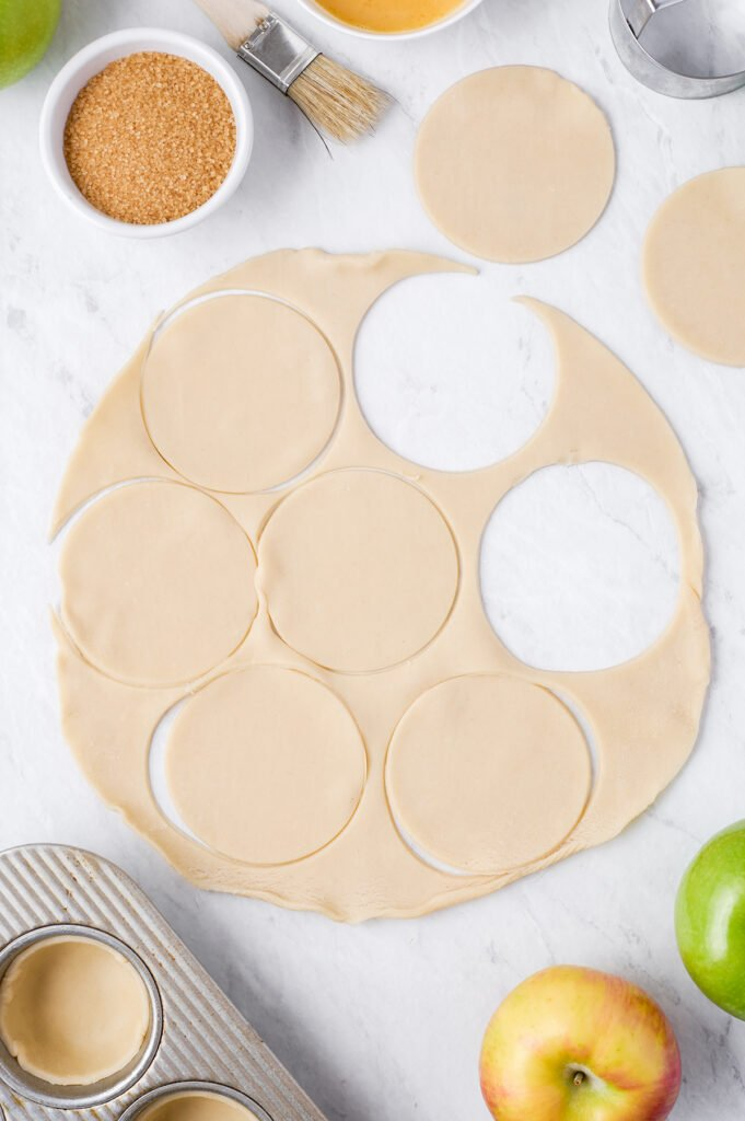 cutting circles out of dough for mini pies