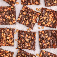 chewy style brownies prepared, cut and spread out on wax paper.