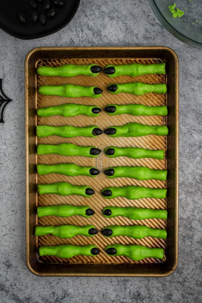 baking sheet with witch finger cookies lined up, ready to serve.